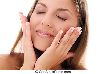 Portrait of a beautiful woman who is holding her hands hear her face