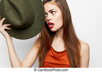 Woman holding hat Open mouth charm sideways glance near face red lips close-up