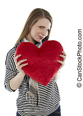 Woman holding heart pillow in the camera
