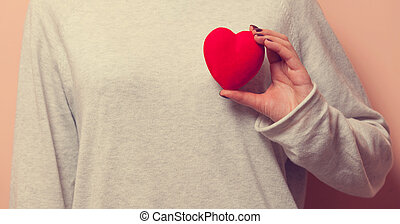 Woman holding heart shape toy