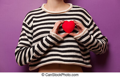 Woman holding heart shape toy as a symbol of Valentine's Day