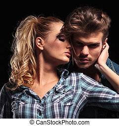 woman holding her boyfriend close to her