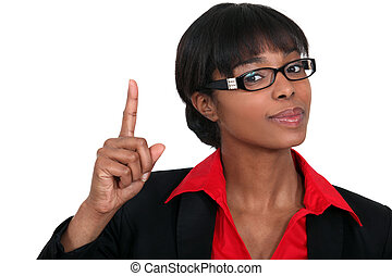Woman holding her index finger up