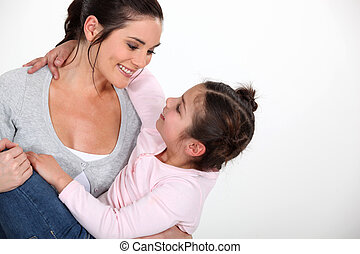 Woman holding her little girl