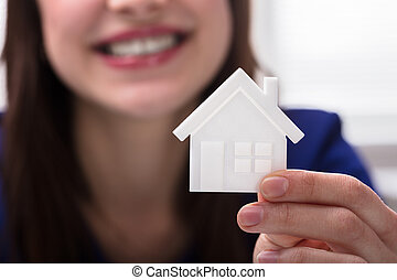 Woman Holding House Model