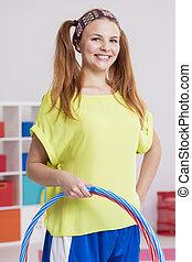Woman holding hula hoops