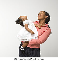 Woman holding infant girl.