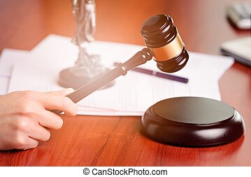 Woman holding judge gavel