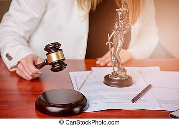 Woman holding judge gavel.