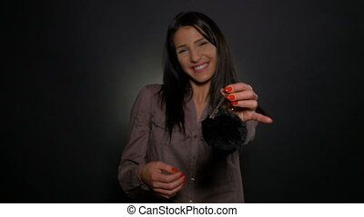 Woman holding keys in her hand and showing it to the camera