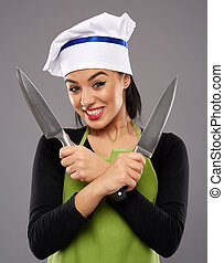 Woman holding knives