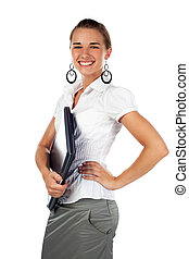 Woman holding laptop with hand on hip.