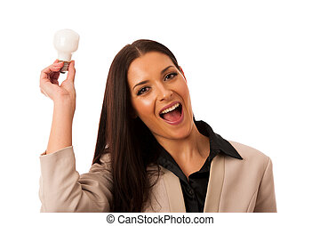 Woman holding light bulb above head as a sign of new idea.