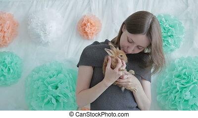 Woman holding little cute rabbit