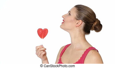 woman holding Lollipop in the shape of heart. Valentine's day