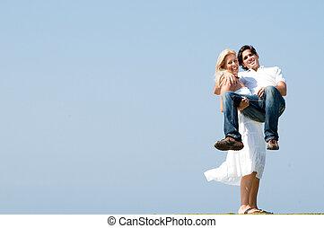 Woman holding man