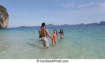 Woman Holding Man Hand Lead Him To People In Water On Beach, Tourists Group On Sea Vacation