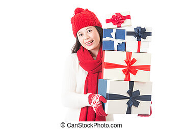 woman holding many Christmas gifts in her arms