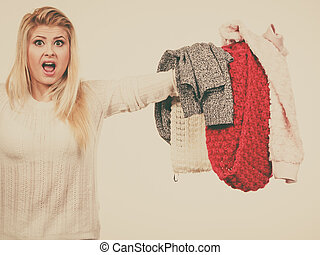 Woman holding many clothing