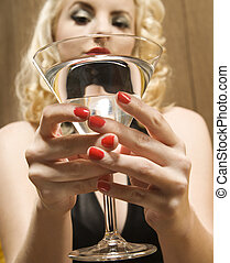 Woman holding  martini.