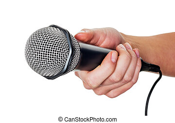 woman holding microphone - a woman is holding a microphone...