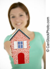 Woman Holding Model House