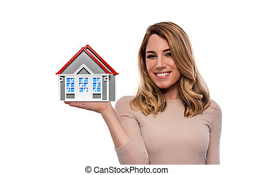 Woman holding model of a house. Isolated on white.