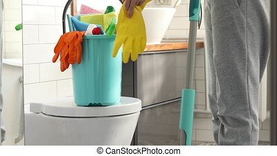 Woman holding mop and bucket with cleaning at home
