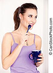 woman holding morning coffee