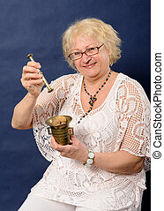 Woman holding mortar and pestle with nuts.