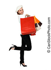 Woman holding numerous shopping bags