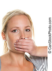 woman holding on to her mouth