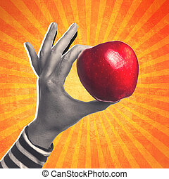 Woman holding organic red delicious apple