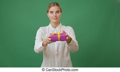 woman holding out a present - Young woman giving a present...