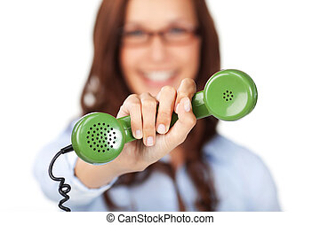 Woman holding out a telephone handset