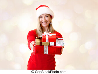 Woman holding out Christmas presents Giving Christmas Spirit