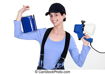Woman holding paint sprayer