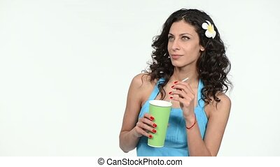 Woman holding paper cup with a straw
