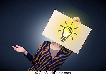 Woman holding paper with lightbulb - Young casual woman...