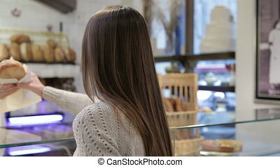 Woman holding pastries