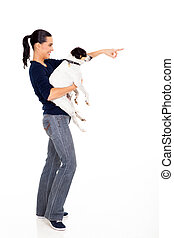 woman holding pet dog