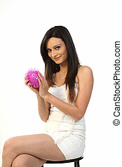 woman holding pink soft toy