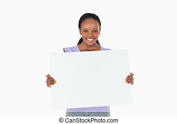 Woman holding placeholder in her hands on white background