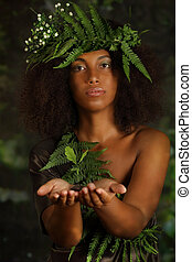 Woman holding plant in her hands