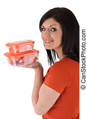 Woman holding plastic container