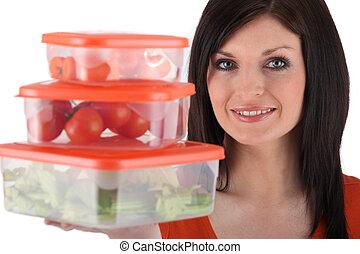 Woman holding plastic food storage