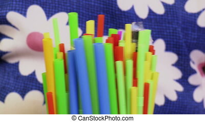 Woman holding plastic straws. Plastic, pollution concept