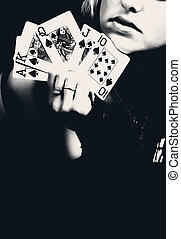 Woman holding playing cards, retro photo.