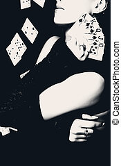 Woman holding playing cards, retro style photo. - Sexy woman...