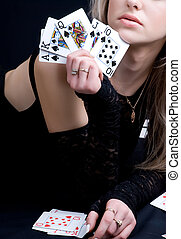 woman holding playing cards